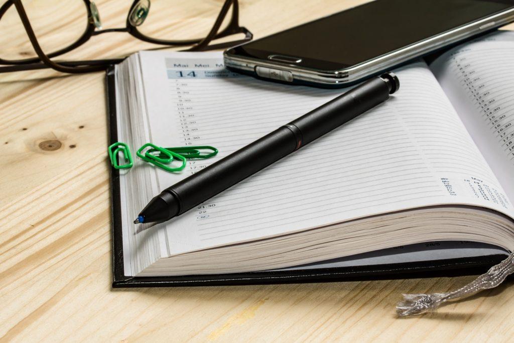 notebook agenda pen mobile phone
